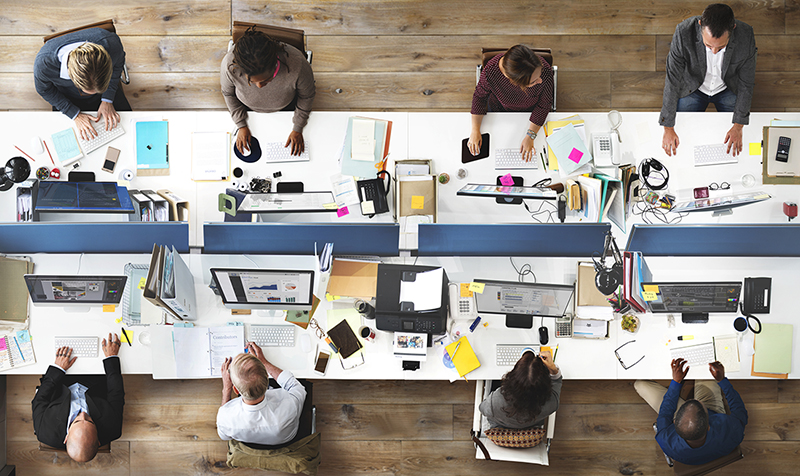 Top view of employees at work around a table