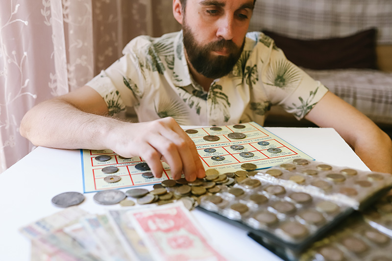 Man counting the coins