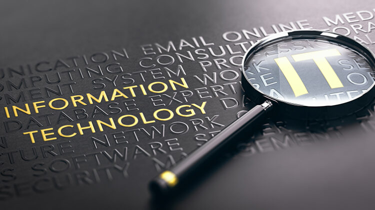 3D illustration of a magnifying glass over black background and focus on golden IT acronym.