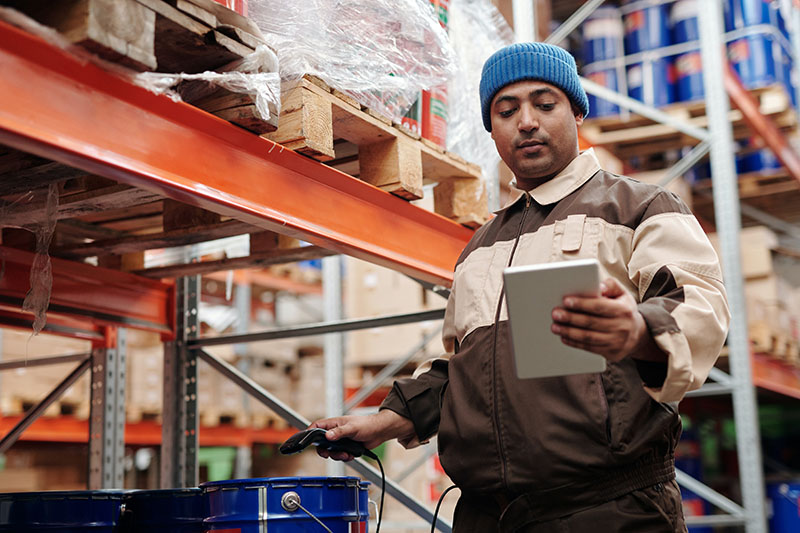 man holding a digital tablet inside the warehouse