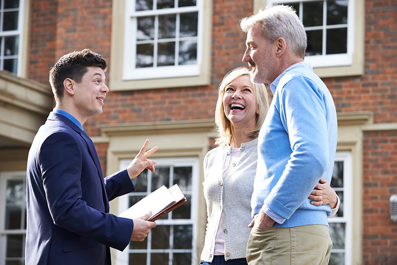 Real estate agent talking to a couple client