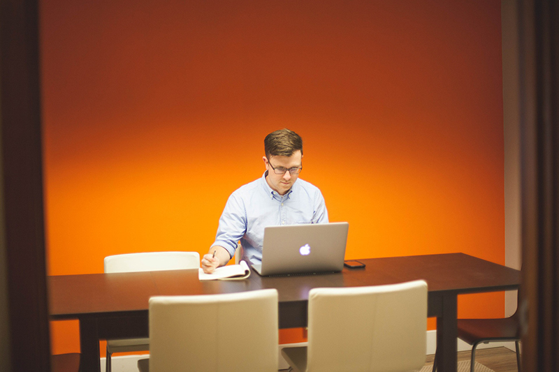 Man working in front of his laptop at home