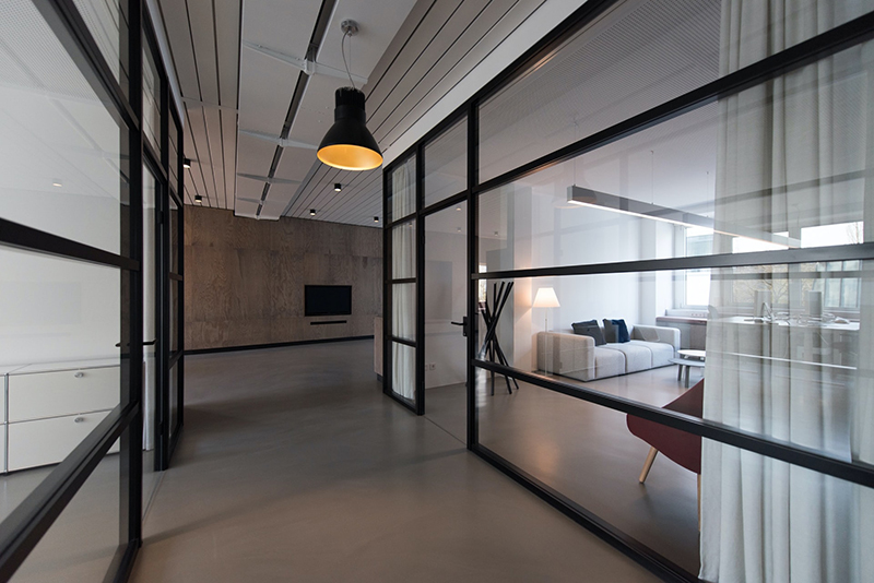 Room with glass wall divider
