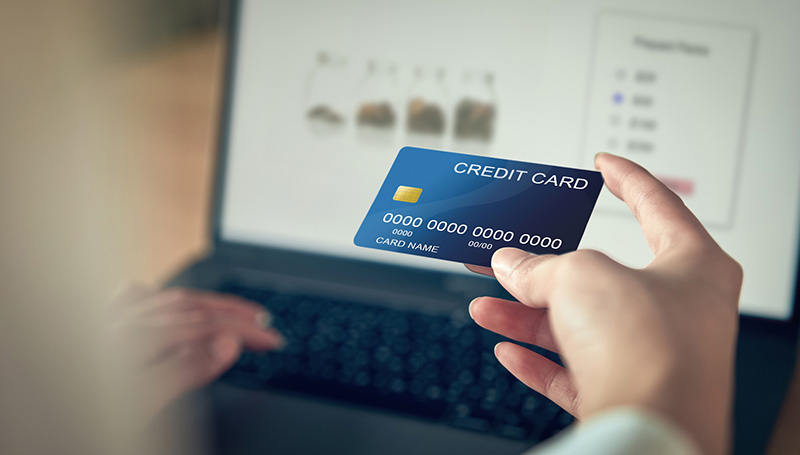 Person using credit card to pay online