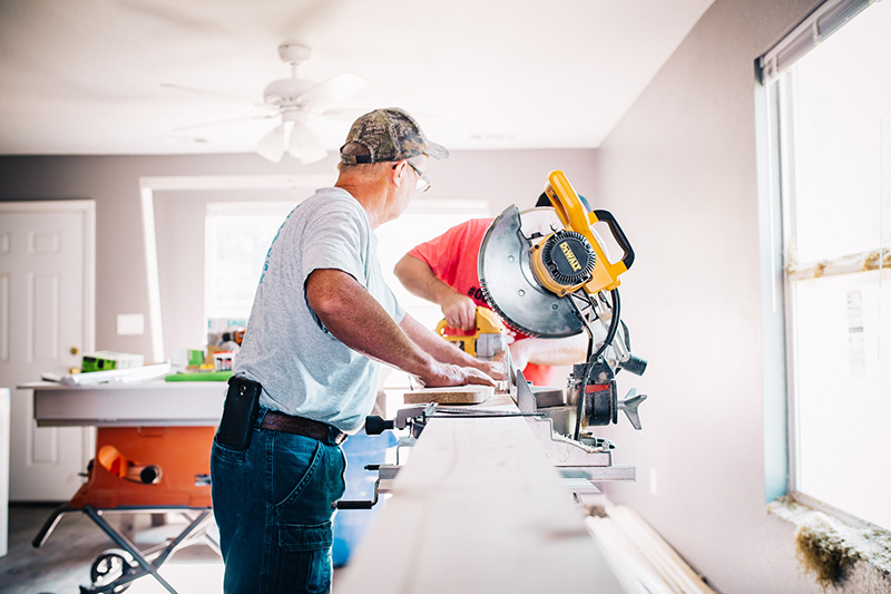 Man standing in front of miter saw