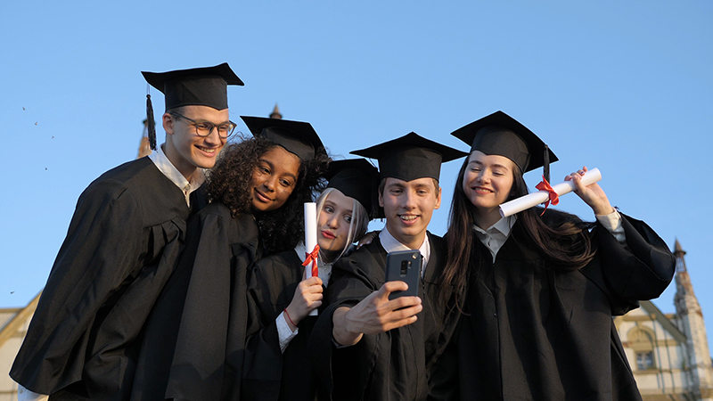 Group of students wearing graduation gown