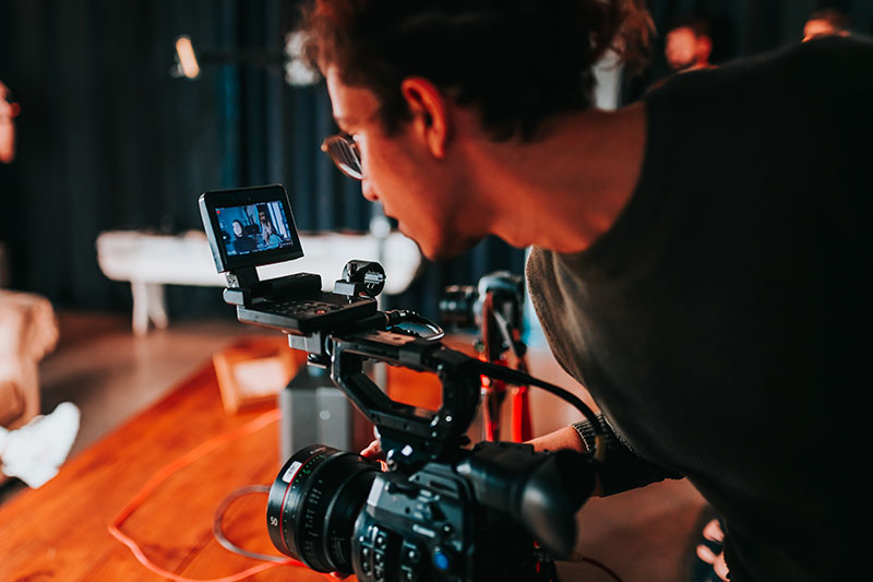 photo of a man holding a video camera