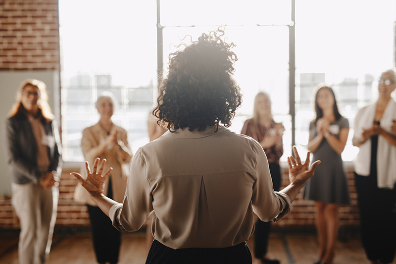 African american female empowering other colleagues in workplace