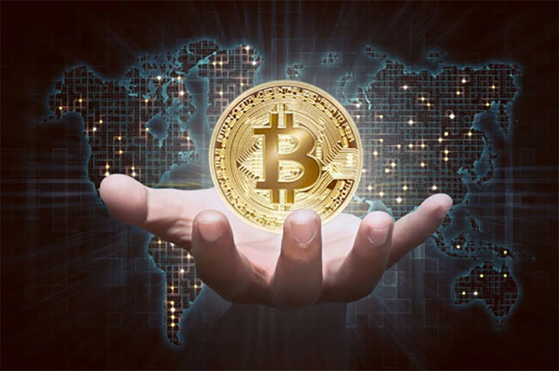 Cryptocurrency bitcoin on person hand