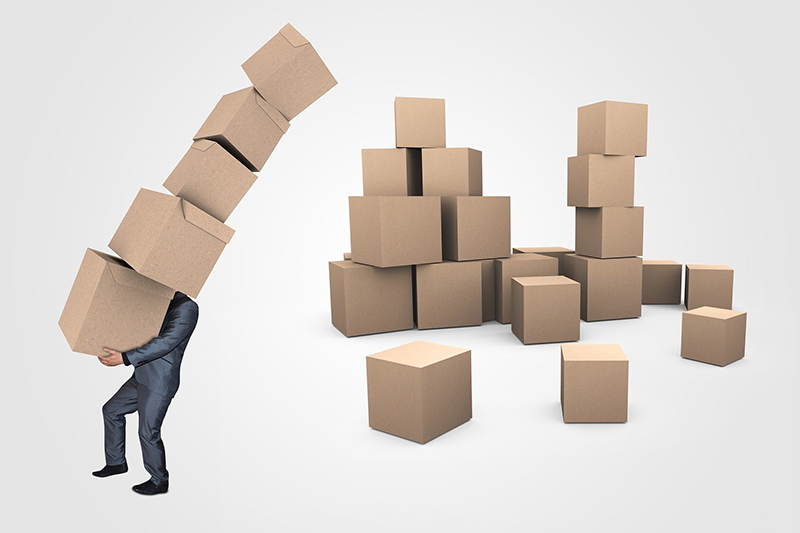 Businessman and boxes for transport