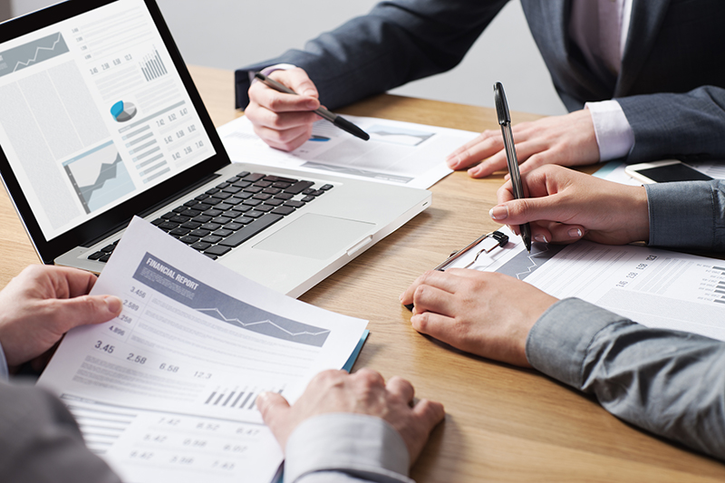 Business professionals working together at office desk