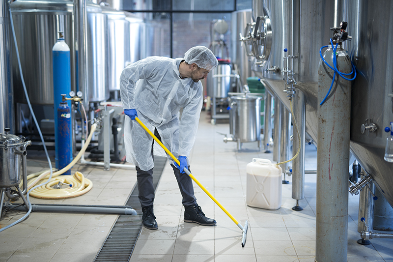 rofessional industrial cleaner in protective uniform