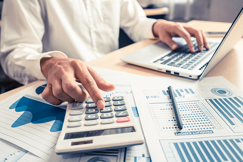 Financial expert analyze business report graph and finance chart at corporate office