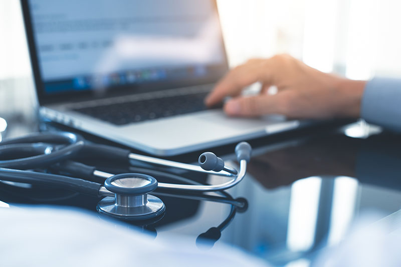 Male doctor hand working on laptop computer