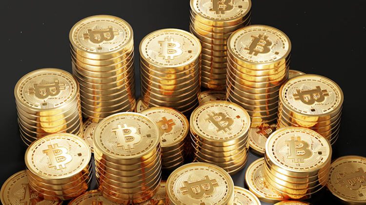 Close up shot of Bitcoin coins isolated on black background