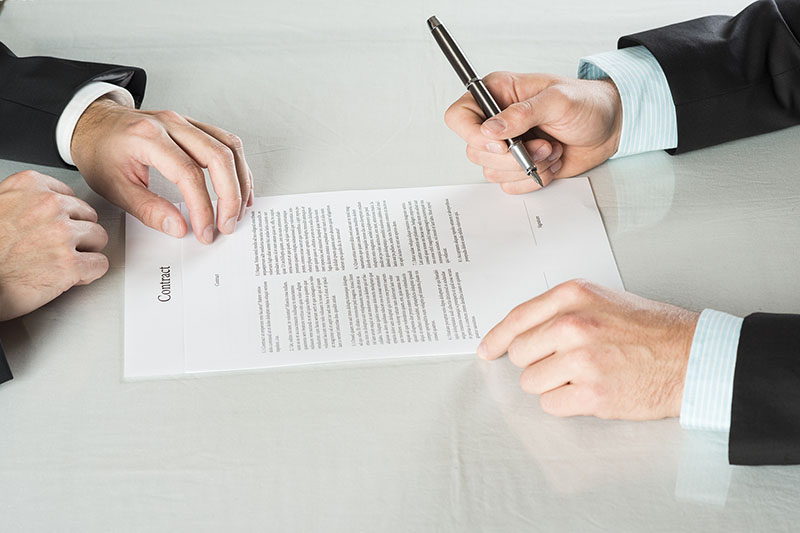Businessmen are signing a contract