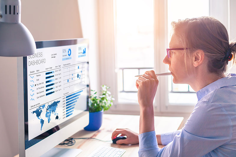 Businesswoman looking at business analytics