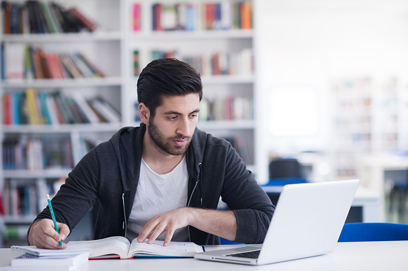 Young man taking an online exam