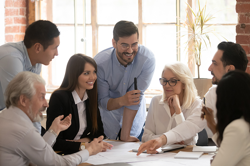 positive employees group engaged in teamwork working together