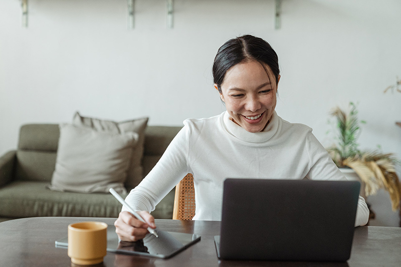 Woman working at home having a video call