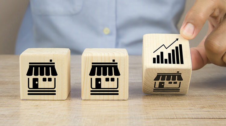 Close-up hand choose graph icon on cube wooden toy blocks