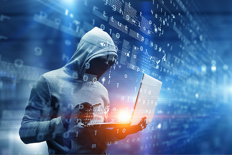 Hacker man with laptop in hands