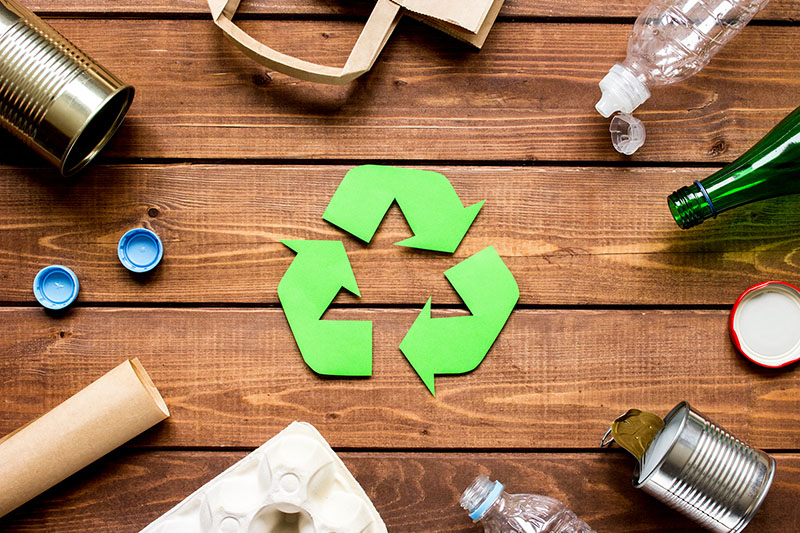 Eco concept with recycling symbol on table background