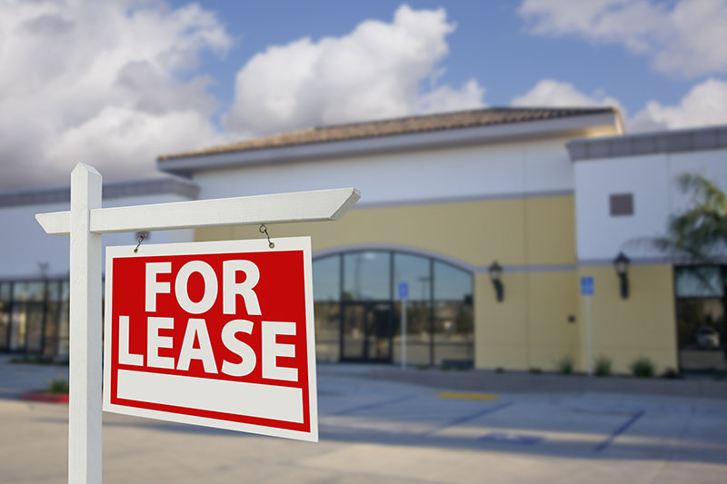 Vacant Retail Building For Lease Real Estate Sign