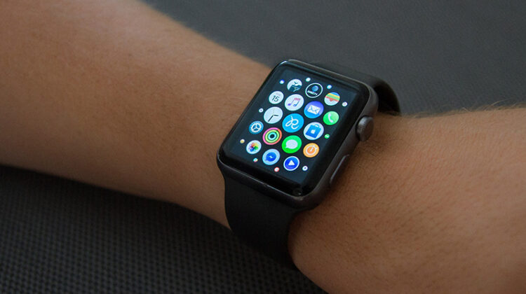 Black apple watch on person hand